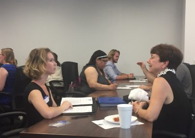 Mentors meet with mentees at a table